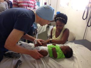 Doctor tends to new born in Hati